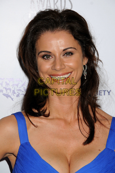 JENNIFER TAYLOR .24th Annual Genesis Awards - Arrivals held at the Beverly Hilton Hotel, Beverly Hills, California, USA, 20th March 2010..portrait headshot  blue cleavage smiling .CAP/ADM/BP.©Byron Purvis/AdMedia/Capital Pictures.