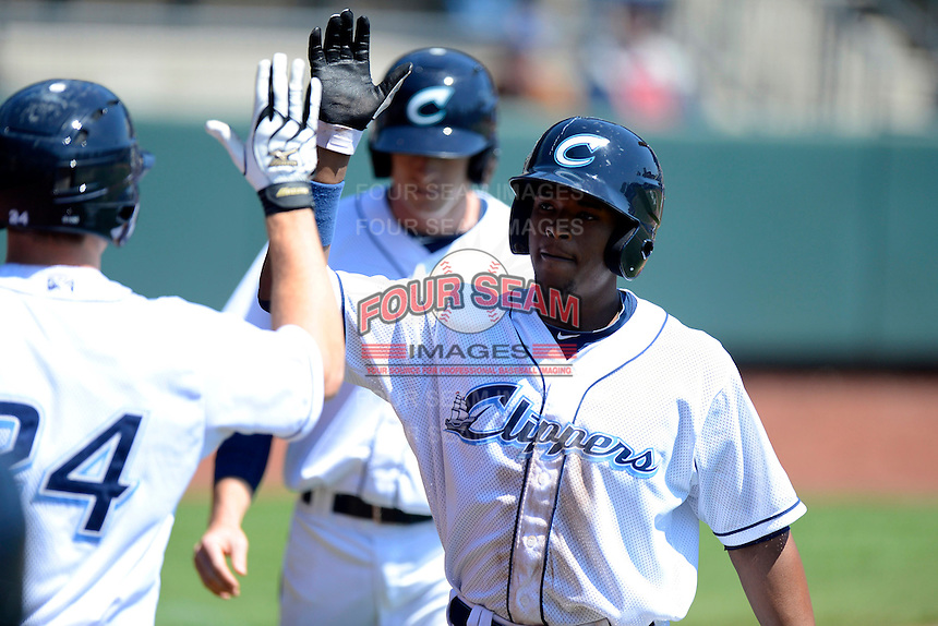 Columbus Clippers outfielder Cedric Hunter #23 after hitting a home run during a game against the Toledo Mudhens on April 22, 2013 at Huntington Park in Columbus, Ohio.  Columbus defeated Toledo 3-0.  (Mike Janes/Four Seam Images)