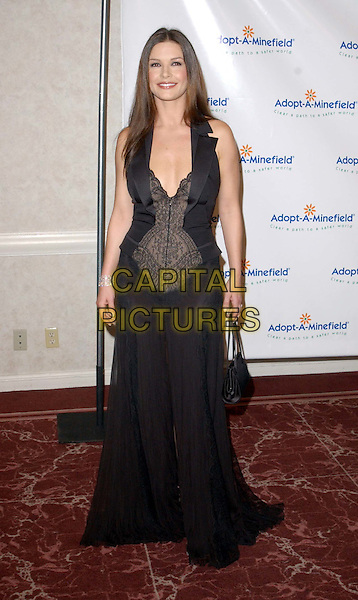 CATHERINE ZETA JONES  .3rd Annual Adopt-A-Minefield Benefit Gala, Beverly Hilton Hotel.full length, full-length, long black dress, plunging neckline, cleavage.www.capitalpictures.com.sales@capitalpictures.com.©Capital Pictures.