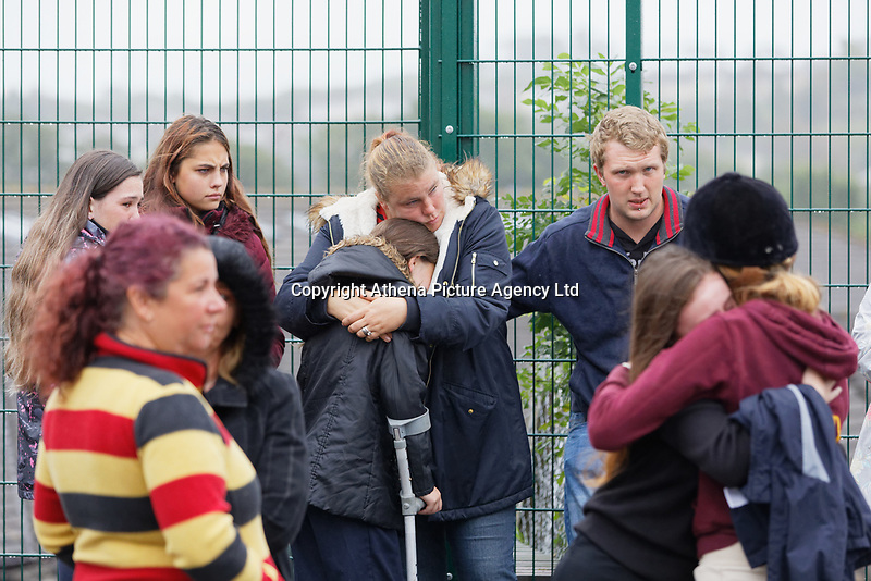 Pictured: Friends and family embrace each other outside St John Lloyd School, in Llanelli, Carmarthenshire, UK. Thursday 12 September 2019<br /> Re: The family of a bullied pupil were joined by friends and held a minute's silence, a year after he hanged himself in school toilets.<br /> His heartbroken father Byron John claims his son Bradley, 14, would still be alive if the school had acted to stop the bullies.<br /> Bradley's 13-year-old sister Danielle found him dead in the toilet block at, an hour after going missing at St John Lloyd Roman Catholic School in Llanelli, South Wales, UK.