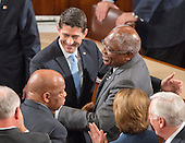 United States Representative James E. Clyburn (Democrat of South Carolina), the Assistant House Democratic Leader, right, greets incoming Speaker of the US House of Representatives Paul Ryan (Republican of Wisconsin), center, as the latter is escorted to the rostrum in the US House Chamber in the US Capitol in Washington, DC on Thursday, October 29, 2015. At bottom left is US Representative John Lewis (Democrat of Georgia).<br /> Credit: Ron Sachs / CNP