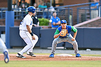 Lexington Legends first baseman Nick Pratto (30) takes the pickoff attempt as Chad Spanberger (24) gets back safely during a game against the Asheville Tourists at McCormick Field on May 25, 2018 in Asheville, North Carolina. The Tourists defeated the Legends 6-4. (Tony Farlow/Four Seam Images)