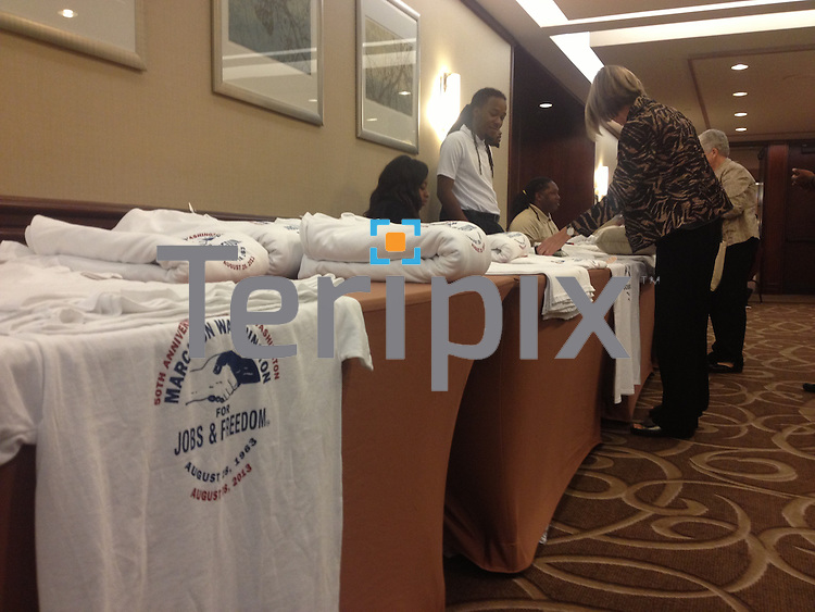 8/27/13 Supporters purchase t-shirts and buttons during the Civil Rights Conference at the Washington Court Hotel.