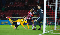 Lincoln City's Matt Green vies for possession with Wolverhampton Wanderers U21's Max Kilman before putting the ball in the back of the net, however his effort was ruled out<br /> <br /> Photographer Chris Vaughan/CameraSport<br /> <br /> The EFL Checkatrade Trophy Northern Group H - Lincoln City v Wolverhampton Wanderers U21 - Tuesday 6th November 2018 - Sincil Bank - Lincoln<br />  <br /> World Copyright © 2018 CameraSport. All rights reserved. 43 Linden Ave. Countesthorpe. Leicester. England. LE8 5PG - Tel: +44 (0) 116 277 4147 - admin@camerasport.com - www.camerasport.com