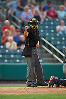 Home plate umpire Charlie Ramos calls a strike during a game between the Lehigh Valley IronPigs and the Rochester Red Wings on June 30, 2018 at Frontier Field in Rochester, New York.  Lehigh Valley defeated Rochester 6-2.  (Mike Janes/Four Seam Images)