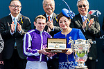 Jockey Ryan Moore riding Highland Reel receives the prize from  Karen Au-Yeung, vice President of LONGINES Hong Kong, after wining the Longines Hong Kong Vase (G1, 2400m) during the Longines Hong Kong International Races at Sha Tin Racecourse on December 10 2017, in Hong Kong, Hong Kong. Photo by Victor Fraile / Power Sport Images