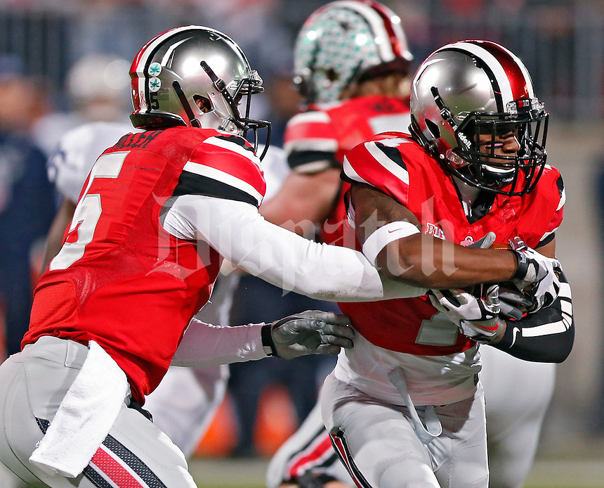 Ohio State Buckeyes running back Dontre Wilson (1) takes the ball from Ohio State Buckeyes quarterback Braxton Miller (5) on a run against Penn State Nittany Lions in the 1st quarter at Ohio Stadium on October 26, 2013.  (Dispatch photo by Kyle Robertson)