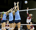 SIOUX FALLS, SD - DECEMBER 8:  Shawn Hotson #20 from the University of South Carolina Aiken tries to get a kill past the defense of Ally Rohn #22, Emma Ballantyne #4 and Olivia Finckel #11 from Palm Beach Atlantic during their quarterfinal match of the NCAA DII Volleyball Championships at the Sanford Pentagon in Sioux Falls, SD. (Photo by Dave Eggen/Inertia)