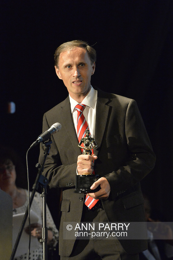 "Bellmore, New York, USA. July 21, 2016. BERNHARD RAMMERSTORFER accepts ""Alan Fortunoff Humanitarian Award"" for documentary""Taking the Stand"" which he was producer, director and writer of, at The19th Annual Long Island International Film Expo Awards Ceremony, LIIFE 2016, held at the historic Bellmore Movies. LIIFE was called one of the 25 Coolest Film Festivals in the World by MovieMaker Magazine."