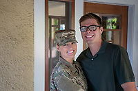 US Military Off Duty woman happy at home posed with husband. Model released, DOD compliant for commercial use.