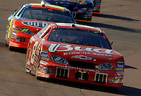 Nov 13, 2005; Phoenix, Ariz, USA;  Nascar Nextel Cup driver Dale Earnhardt Jr. , driver of the #8 Budweiser Chevy leads Jeff Gordon during the Checker Auto Parts 500 at Phoenix International Raceway. Mandatory Credit: Photo By Mark J. Rebilas