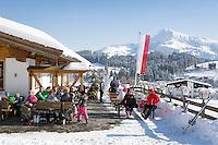 Austria, Tyrol, Reith near Kitzbuhel at Brixen Valley: ski hut, at background Kitzbuhel Horn mountain | Oesterreich, Tirol, Reith bei Kitzbuehel im Brixental: Skihuette, im Hintergrund das Kitzbueheler Horn