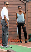United States President Barack Obama and First Lady Michelle watch as The President misses the hole while playing miniature golf with daughter Sasha at Pirate's Island Miniature Golf in Panama City Beach, Florida USA on Saturday, 14 August  2010.  The First Family is visiting the area to help promote tourism and check up on clean up efforts from the aftermath of the Deepwater Horizon Oil spill.  .Credit: Dan Anderson / Pool via CNP