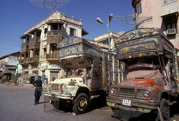 Traditionally decorated trucks and housing.