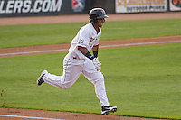 Wisconsin Timber Rattlers infielder Francisco Castillo (23) runs to first base during a Midwest League game against the Lake County Captains on June 3rd, 2015 at Fox Cities Stadium in Appleton, Wisconsin. Wisconsin defeated Lake County 3-2. (Brad Krause/Four Seam Images)
