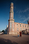 A mother and son walk past the mosque in Dushanbe, Tajikistan.