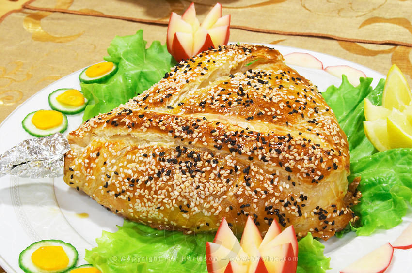 Whole baked in the oven leg of lamb with sesame seed decoration en croute. Efendi Efendy traditional Turkish and Ottoman Restaurant, The Block, Tirana. Albania, Balkan, Europe.