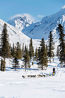 Mats Pettersson runs on Puntilla Lake with the Alaska Range in the background shorlty before arriving at the Rainy Pass checkpoint during the 2018 Iditarod race on Monday March 05, 2018. <br /> <br /> Photo by Jeff Schultz/SchultzPhoto.com  (C) 2018  ALL RIGHTS RESERVED
