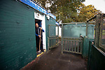A club official sweeping out the referee's room before Nelson hosted Daisy Hill in a North West Counties League first division north fixture at Victoria Park. Founded in 1881, the home club were members of the Football League from 1921-31 and has played at their current ground, known as Little Wembley, since 1971. The visitors won this fixture 6-3, watched by an attendance of 78.