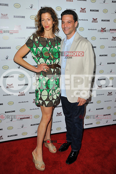 Alysia Reiner and David Alan Basche at the premiere of Morgan Spurlock's 'Mansome' at the ArcLight Cinemas on May 9, 2012 in Hollywood, California. ©mpi35/MediaPunch Inc.