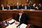 Rachel Mitchell, a prosecutor from Arizona, waits for Christine Blasey Ford, the woman accusing Supreme Court nominee Brett Kavanaugh of sexually assaulting her at a party 36 years ago, to testify before the US Senate Judiciary Committee on Capitol Hill in Washington, DC, September 27, 2018.  / AFP PHOTO / POOL / SAUL LOEB / AFP PHOTO / POOL / Saul LOEB