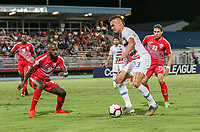 GEORGETOWN, GRAND CAYMAN, CAYMAN ISLANDS - NOVEMBER 19: Aaron Long #3 of the United States moves with the ball as Jose Almelo #18 of Cuba defends during a game between Cuba and USMNT at Truman Bodden Sports Complex on November 19, 2019 in Georgetown, Grand Cayman.