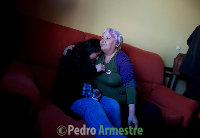 A pscychologist (R) comforts Ecuadorian homeowner Kelly Herrera on March 13, 2012 in her house in Madrid before her eviction. Spain on March 9 approved a new voluntary 'code of conduct' for banks which aims to help poor homeowners settle their debts and reduce a wave of evictions brought on by the economic crisis. Spanish banks currently seize the homes of those who default on their mortgages and often demand further payment from those evicted if the value of the house has fallen below that of the loan. The new rules will apply in cases where every member of a household is unemployed and mortgage payments are equal to more than 60 percent of their income. (c) Pedro ARMESTRE