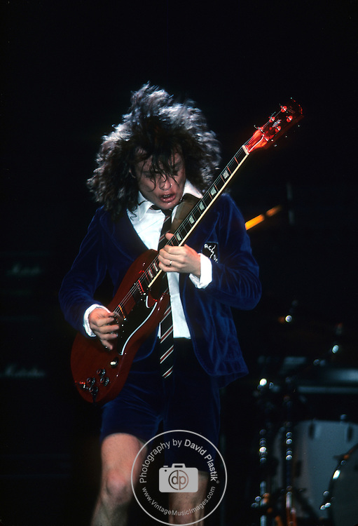 Pictures of rock band AC-DC performing in concert during the 1980's Angus Young