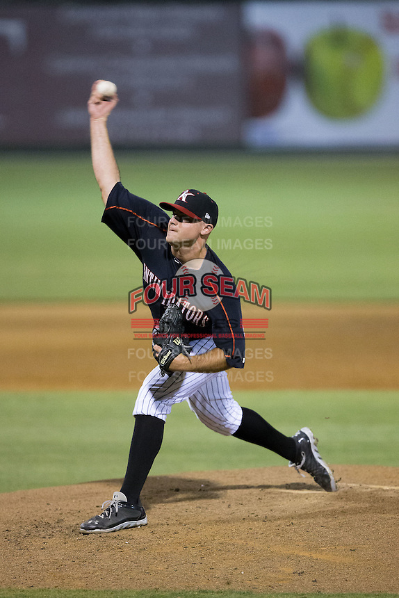 Kannapolis Intimidators relief pitcher Matt Cooper (32) in action against the Greensboro Grasshoppers at CMC-Northeast Stadium on June 11, 2015 in Kannapolis, North Carolina.  The Intimidators defeated the Grasshoppers 7-6.  (Brian Westerholt/Four Seam Images)