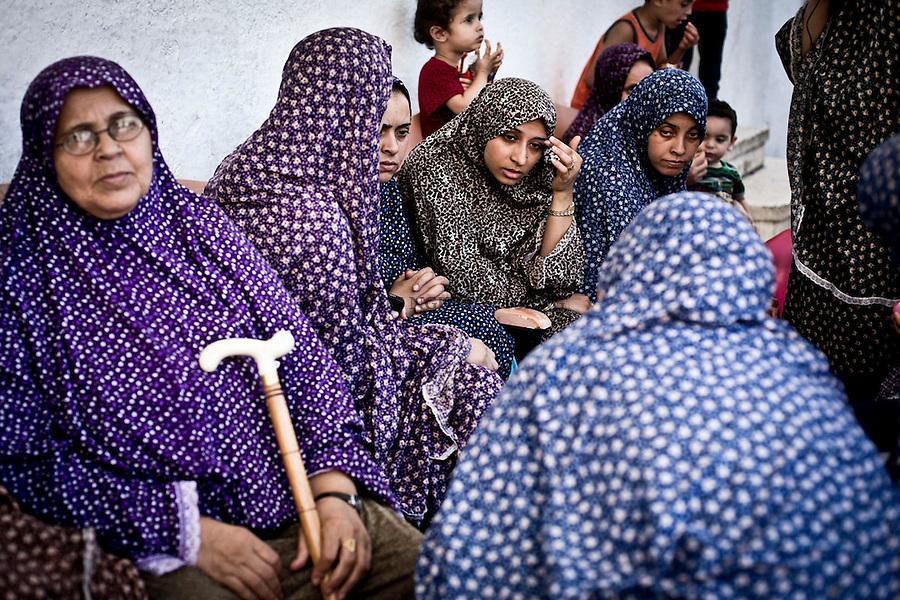 GAZA: Women are talking with each other at the entrance of the Saint Porphyrios Church's courtyard. They have all lost their home during the shellings in Gaza.<br /> <br /> GAZA: Des femmes discutent &agrave; l'entr&eacute;e de la cour de l'&eacute;glise Saint Porphyre o&ugrave; elles se sont r&eacute;fugi&eacute;es. 31 juillet 2014