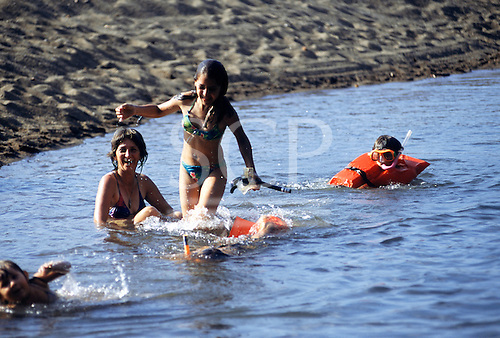 Osa Peninsula, Costa Rica. Family snorkelling on the beach.