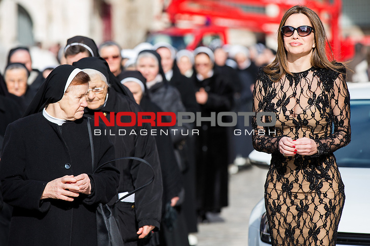 26.01.2013. Croatia, Dubrovnik - Popular Croatian singer Severina on promotion of the new VW Golf attracted the attention of the nuns, priests and passers-by who were at the same time in a procession on downtown Stradun. Photo: Grgo Jelavic/PIXSELL