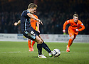 Dundee's Greg Stewart scores their first goal from the spot.