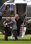 United States President George W. Bush greets a Marine guard as he steps off Marine One followed by first lady Laura Bush after a visit to Camp David at the White House in Washington on June 29, 2008.<br /> Credit: Kevin Dietsch / Pool via CNP