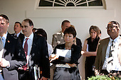 Washington, DC - October 9, 2009 -- Senior Advisors Valerie Jarrett and David Axelrod, along with other staff, watch from the Colonnade as President Barack Obama makes a statement on winning the 2009 Nobel Peace Prize in the Rose Garden of the White House, October 9, 2009. .Mandatory Credit: Lawrence Jackson - White House via CNP