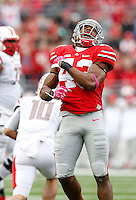 Ohio State Buckeyes linebacker Darron Lee (43) celebrates sacking Rutgers Scarlet Knights quarterback Gary Nova (10) during the second quarter of the NCAA football game at Ohio Stadium in Columbus on Oct. 18, 2014. (Adam Cairns / The Columbus Dispatch)