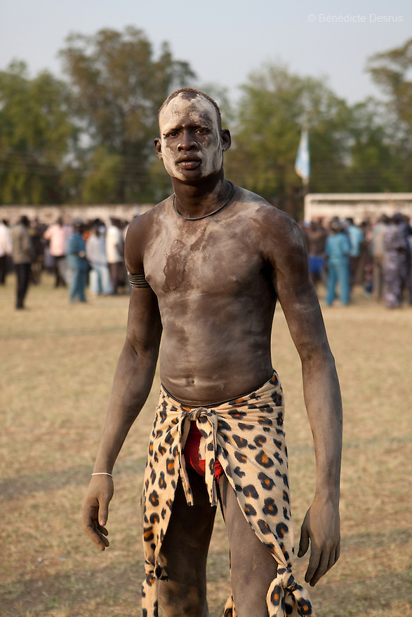 Sunday 5 december 2010 - Juba, Southern Sudan - A Dinka wrestler before the match. Traditional wrestling matches in Juba Stadium between Dinka wrestlers from Yirol East of Lake State and Mundari wrestlers from Terekeka County of Central Equatoria State. The matches attracted large numbers of spectators who sang, played drums and danced in support of their favorite wrestlers. The match organizers hoped that the sport would bring together South Sudan's many different tribes.Photo credit: Benedicte Desrus