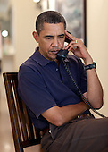 Kailua, HI - December 31, 2009 -- United States President Barack Obama participates in conference call with National Security Council (NSC) chief of staff Denis McDonough and homeland security advisor John Brennan about preliminary assessments from the ongoing consultations the President has ordered in human and systematic failures that occurred leading up to attempted terrorist Christmas Day attack. The phone call took place in Kailua, Hawaii, Thursday, December 31, 2009..Mandatory Credit: Pete Souza - White House via CNP