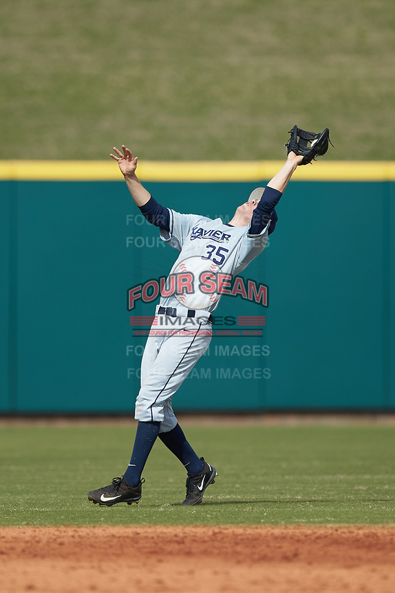 Chris Givin (35) of the Xavier Musketeers catches a fly ball in the game against the Penn State Nittany Lions at Coleman Field at the USA Baseball National Training Center on February 25, 2017 in Cary, North Carolina. The Musketeers defeated the Nittany Lions 10-4 in game one of a double header. (Brian Westerholt/Four Seam Images)