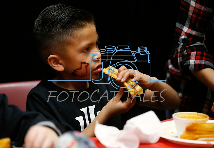 Dylan Hernandez, 6, enjoys lunch at the La Posada Celebration at Western Nevada College, in Carson City, Nev., on Saturday, Dec. 15, 2018. <br /> Photo by Cathleen Allison/Nevada Momentum