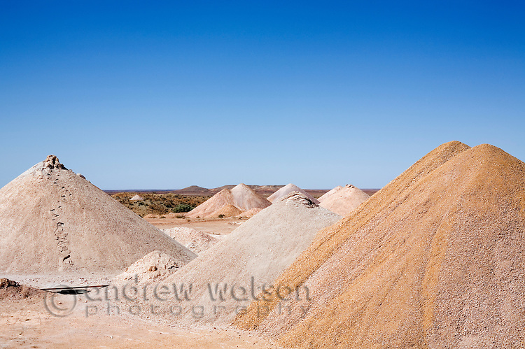 Conical piles of dirt from the many mines shafts dug in the Coober Pedy opal fields.  Coober Pedy, South Australia, AUSTRALIA.