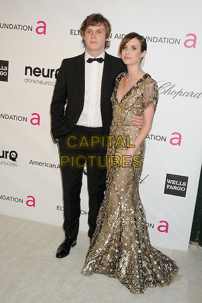 Emma RobertsEvan Peters, Emma Roberts21st Annual Elton John Academy Awards Viewing Party held at West Hollywood Park, West Hollywood, California, USA..February 24th, 2013.oscars full length gold black sequined sequined dress sheer clutch bag tuxedo couple white shirt black.CAP/ADM/BP.©Byron Purvis/AdMedia/Capital Pictures.