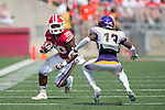 Wisconsin Badgers running back James White (20) carries the ball  during an NCAA football game against the Tennessee Tech Golden Eagles  Saturday, September 7, 2013, in Madison, Wis. The Badgers won 48-0.  (Photo by David Stluka)
