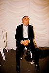 DRUNKEN MAN, SITTING PASSED OUT ON A CHAIR, WITH HIS MOUTH OPEN AT THE ROYAL AGRICULTURAL COLLEGE MAY BALL, CIRENCESTER, GLOUCESTERSHIRE,