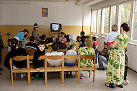 Chechen children in the TV room, watching  telecast on the National Russian TV, in the URiC Bielany Refugee Centre in Poland..-For security reason, the face of the adult asylum seeker have been evicted of the photography..-For security reason, the names of the adult asylum seeker have been change. .-Article 9 of the Act of 13 June 2003 on grating protection on the Polish territory (Journal of Laws, No 128, it. 1176) personal data of refugees are an object of particular protection..-Cases where publication of a picture or name of asylum seeker had dramatic consequences for this persons and is family back in Chechnya. .Please have safety of those people in mind. Thank you.