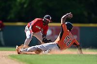 Boston Red Sox Luis Alejandro Basabe (16) puts the tag on Yariel Vargas (58) sliding in during a minor league spring training game against the Baltimore Orioles on March 20, 2015 at Buck O'Neil Complex in Sarasota, Florida.