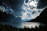 Cumulus clouds form over the Rocky Mountains, St. Mary Lake, Glacier National Park, Montana, USA