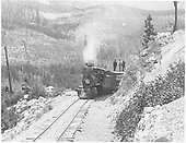 Engine #200 with 3 people on box car in mountains.<br /> D&amp;RG