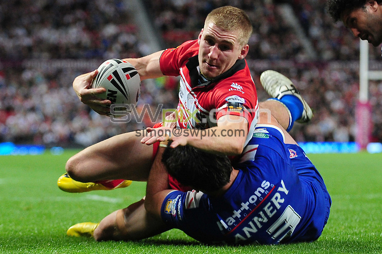 PICTURE BY ALEX BROADWAY/SWPIX.COM - Rugby League - Super League Grand Final - Wigan v St Helens - Old Trafford, Manchester, England - 02/10/10...Copyright - Simon Wilkinson - 07811267706...Wigan's Sam Tomkins scores a try.