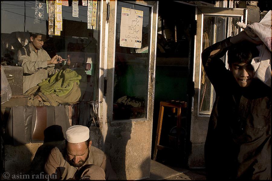 a local barbar shop in a peshawar bazaar